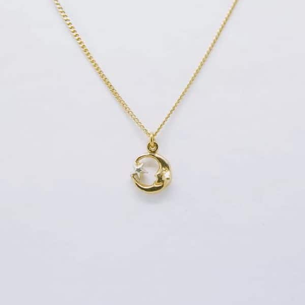 22ct gold plated silver mini moon and star pendant necklace with silver details, handmade by Manom Jewellery
