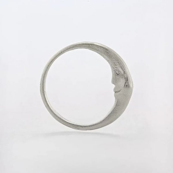 Sterling silver ring with hidden crescent moon inside and engraved star details, handmade by Manom Jewellery
