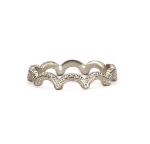 Sterling silver wiggle ring with textured details, handmade by Rosie Kent.