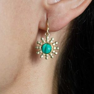 Close up shot of model wearing Azuni Malachite Sun Drop Earrings