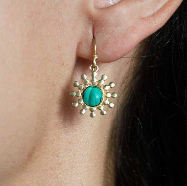 Close up shot of model wearing Azuni Malachite Sun Drop Earrings