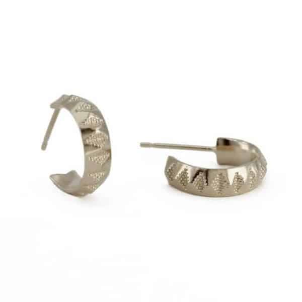 Sterling silver faceted hoops with a textured design, by Rosie Kent
