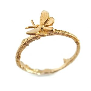 22ct gold plated sterling silver textured band ring with a tiny butterfly sitting on the band, by Alex Monroe