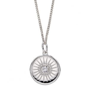 Sterling silver disc pendant with a cubic zirconia stone and engraved line details
