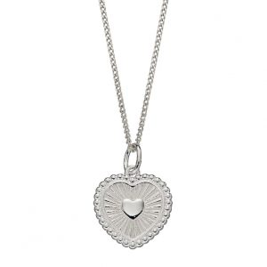 Sterling silver heart shaped pendant with an engraved sunray design