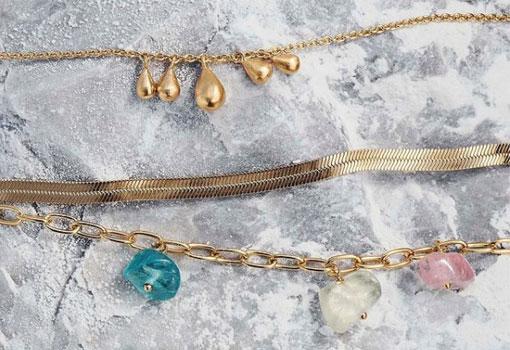 Three Pernille Corydon gold bracelets.