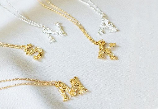 Alex Monroe Floral letter necklaces in silver and gold