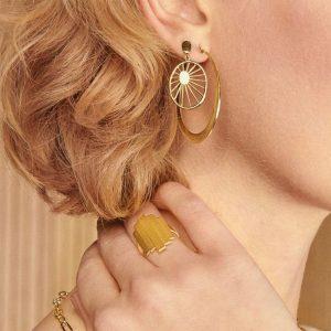 Lady wearing Gold daydream drop earrings by Pernille Corydon