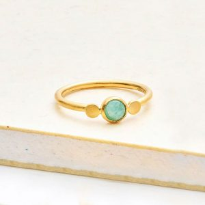 Gold ring with central amazonite gemstone and 2 silver discs either side from pernille corydon