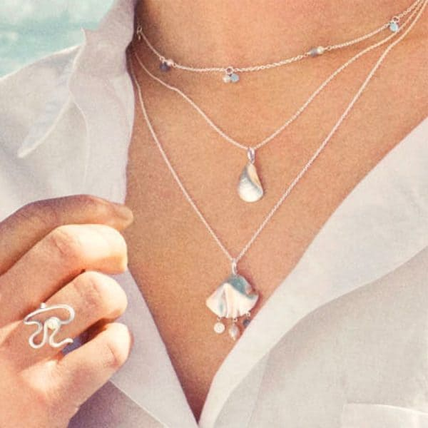 Lady wearing silver seashell necklace