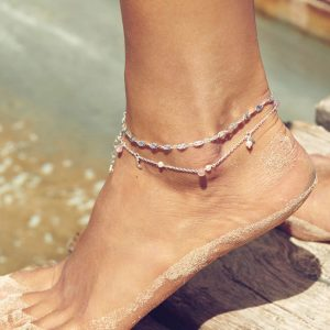 A close up of a ladys foot wearing a silver anklet from pernille Corydon