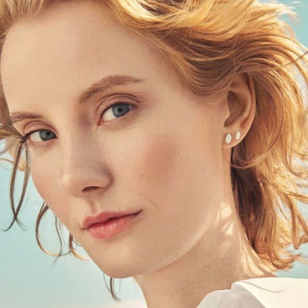 Lady wearing silver ocean stars stud earring by pernille corydon