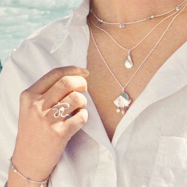 Lady wearing silver sea treasures necklace from Pernille Corydon