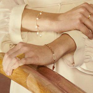 Lady wearing gold esther bracelet by Pernille Corydon