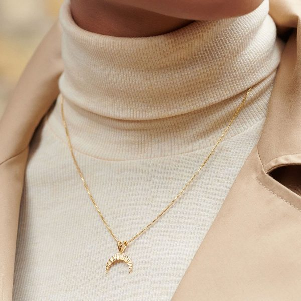 Model wearing rachel jackson crescent moon necklace